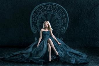 Blonde woman sitting on a throne