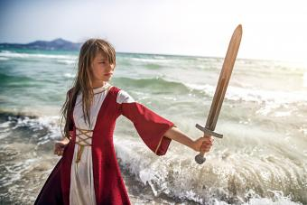 Young viking practicing with sword
