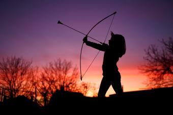 Little archer in sunset