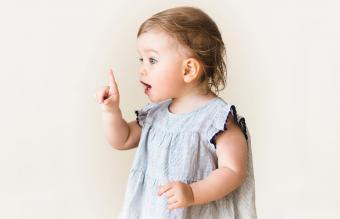 Baby girl pointing her finger