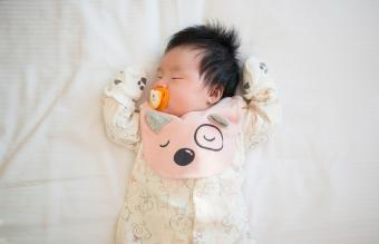 Newborn baby sleeping in bed