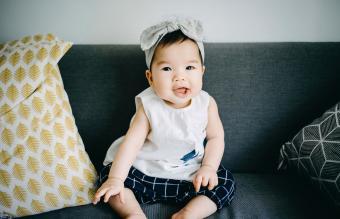 baby girl smiling joyfully