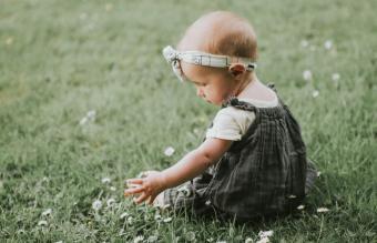 Baby girl sitting on grass