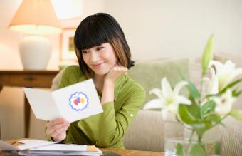 woman reading thank you card