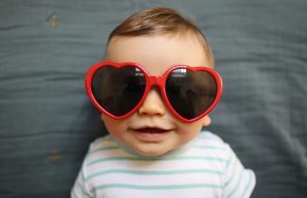 baby boy wearing heart shaped glasses
