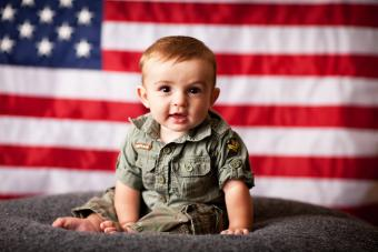 Patriotic baby boy with American flag background