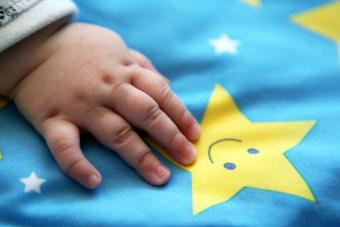 Sleeping baby with hand on a star