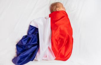 baby wrapped in French flag