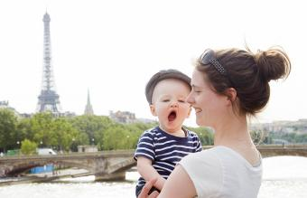 Mom standing with yawning toddler