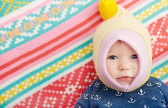 baby on colorful rug