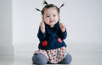 cute toddler girl grimacing