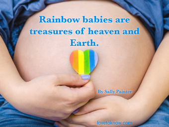 Pregnant woman shows a rainbow heart on her belly and rainbow baby quote