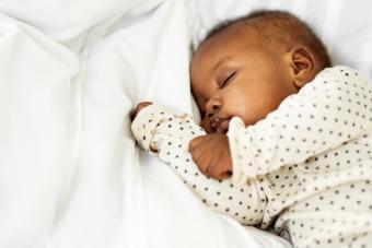 Baby girl sleeping peacefully at home