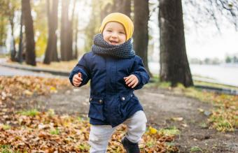 Baby Boy Standing In Park