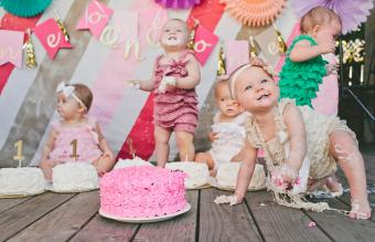 Cute baby girls with birthday cakes