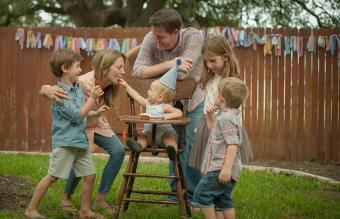Family celebrating baby boys' first birthday
