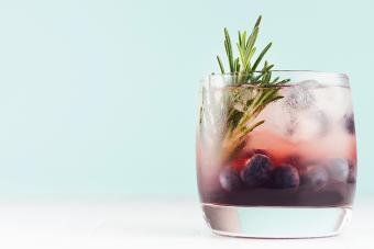 Summer fresh blueberry mocktail in glass with blueberries, ice cubes and rosemary