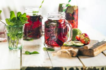 Iced tea with fruits, hibiscus, strawberries, mint and limes