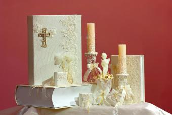 Christening accessory set of decorated candles and holy bible books