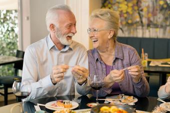 Senior couple opening fortune cookies
