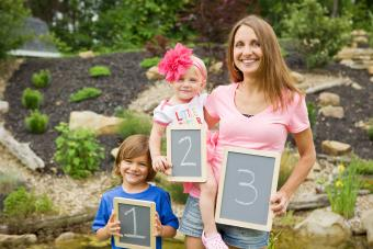 A mom and her two kids showing the birth order including a 3rd one on the way.
