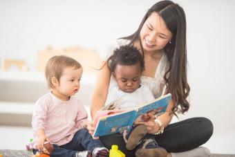 babysitter reads book to the babies