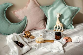 Newborn unisex baby necessities and clothing on cozy nursery