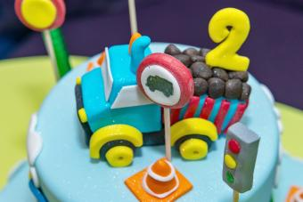 Kids cake decorated with Construction machinery