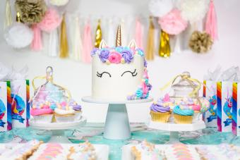 party table with unicorn cake
