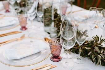 Boho Table Decoration with olive branches and rose drink glasses