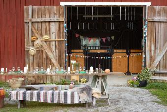 Table against barn during party