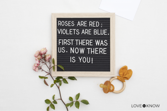 Pregnancy announcement with a poem, with a pacifier and toy