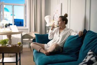 Woman relaxing after work at home
