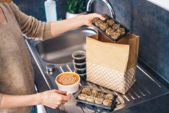 Woman unpacking takeaway food delivery