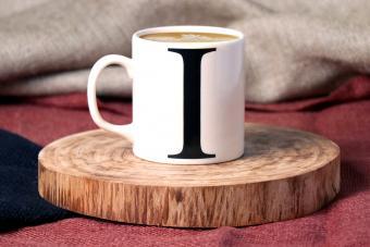 Coffee mug on wooden board