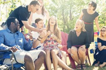 Parents tasting baby food at shower party in summer