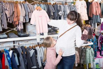 Family chooses clothes for newborns