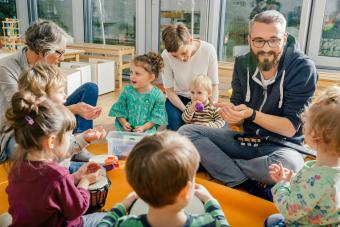 Children and teachers playing