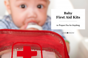 Baby with a first aid kit