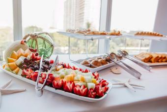 Close up of fruit and muffins at breakfast buffet