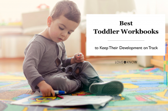 Toddler working with a workbook