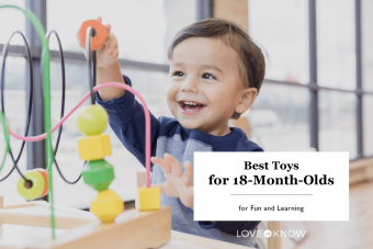 Toddler boy enjoys playing with toys