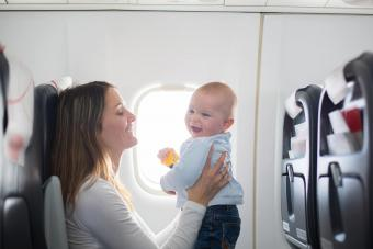 mom with baby at airplane
