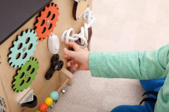 Baby playing with diy sensory board