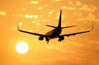 Passenger jet flying into the sunset