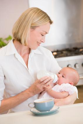 Mother Feeding Infant A Bottle