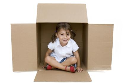 toddler girl in box