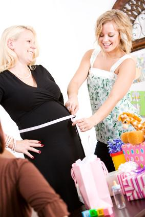 Women playing a baby shower game
