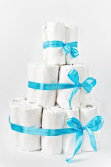 Diaper cake wrapped with blue ribbon