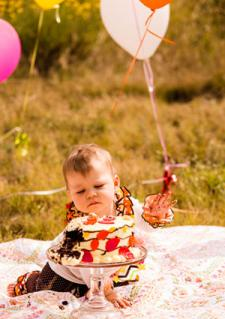 Baby with cake and balloons